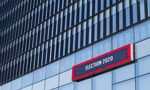 A building with a sign indicating it is a polling place for the US Presidential election.